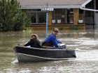 Roger Poirier, and his wife Crystal use their boat to collect belongings from their flooded house in High river, Alta. Heavy rains have caused flooding, closed roads, and forced evacuation in High River, Alta., Thursday, June 20, 2013.THE CANADIAN PRESS/Jeff McIntosh